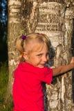 Little girl hug a tree Stock Images