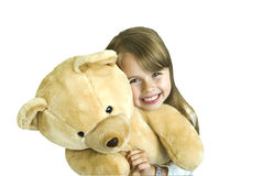 Little girl with huge bear. The girl is hugging big teddy bear Stock Image
