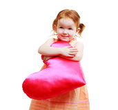 Little girl with huge bright red heart Stock Photos