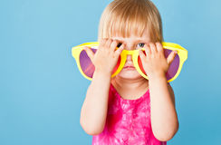 A little girl with a huge sunglasses Stock Photography