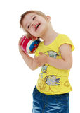 Little girl hugging the ball. Stock Images