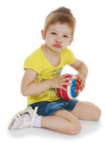 Little girl hugging the ball. Royalty Free Stock Photography