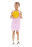 Little girl hugging the ball. Royalty Free Stock Image