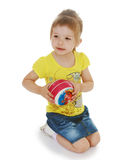 Little girl hugging the ball. Stock Image