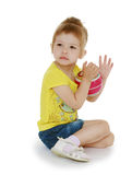 Little girl hugging the ball. Stock Photos