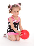 Little girl hugging the ball. Royalty Free Stock Photo