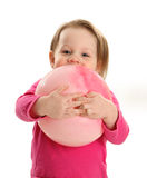 Little girl hugging a ball Stock Image