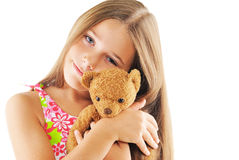 Little girl hugging bear toy Royalty Free Stock Photo