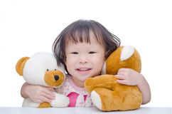 Little girl hugging bear toy Royalty Free Stock Photography