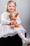 Little girl hugging bear toy and smiling Stock Photography