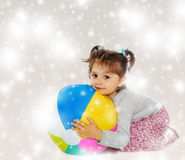 Little girl hugging a big ball Stock Images