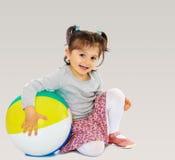 Little girl hugging a big ball Stock Photo