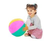 Little girl hugging a big ball Royalty Free Stock Photo