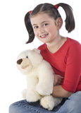 Little girl is hugging big teddy bear Stock Photo