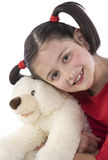 Little girl is hugging big teddy bear Stock Photography
