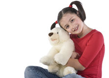 Little girl is hugging big teddy bear Royalty Free Stock Photos