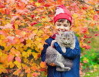 Little girl hugging a cat Stock Photography