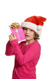 Little girl hugging christmas present Stock Photo