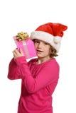 Little girl hugging christmas present Stock Photo