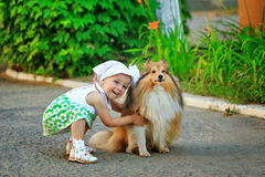 Little girl hugging a dog. Royalty Free Stock Photos