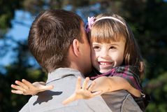 Little girl hugging embracing her father Stock Photography