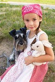 Little girl hugging her dog Stock Images