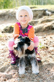 Little girl hugging her dog Stock Photography
