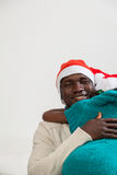 Little girl hugging her father on Christmas Stock Images