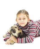 Little girl hugging her four-footed friend Stock Images