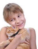 Little girl hugging with her kitten Royalty Free Stock Photos