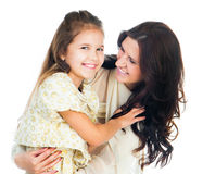 Little girl hugging her mother Stock Image