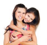 Little girl hugging her mother Stock Image