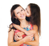 Little girl hugging her mother Royalty Free Stock Image