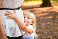 Little girl hugging her mother. And smile outdoors Royalty Free Stock Photo