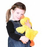 Little girl hugging her stuffed toy. On white Royalty Free Stock Photography