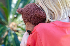 Little girl hugging her teddy Royalty Free Stock Images