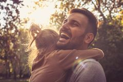 Little girl hugging his Daddy. Close up. Single smiling father with daughter stock photo