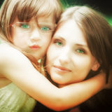 Little girl hugging his mother expressing tender feelings. Love. Stock Photography