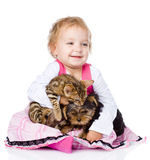 little girl hugging a kitten and a puppy. isolated on white Royalty Free Stock Photography