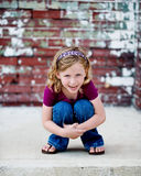Little Girl Hugging Knees Royalty Free Stock Images