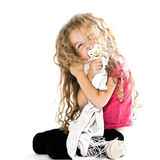 Little girl hugging pacifier blanket smiling Royalty Free Stock Photography