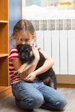 Little girl hugging a puppy Stock Photography