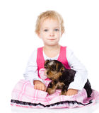 Little girl hugging a puppy. isolated on white background Royalty Free Stock Photo