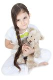 Little girl is hugging teddy bear Stock Photography