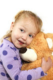 Little girl hugging a teddy bear Royalty Free Stock Images