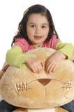 Little girl hugging a teddy bear Stock Images