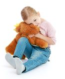 Little girl hugging a teddy bear. Royalty Free Stock Photo