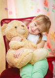 Little girl hugging Teddy bear Royalty Free Stock Photos