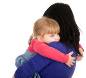Little girl hugging to mother Stock Photos