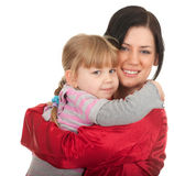 Little girl hugging to mother Stock Image